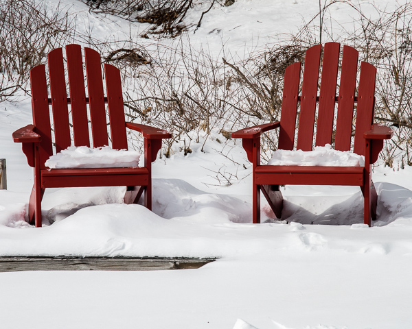 Red Chairs on Dock in Snow